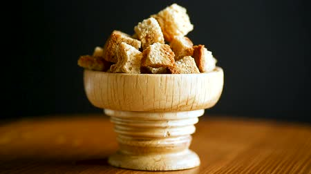grain bread : fried bread crumbs diced in a wooden bowl