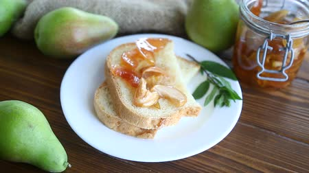 grzanki : pieces of bread with sweet home-made fruit jam from pears and apples in a plate