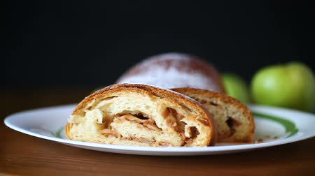 изюм : sweet homemade strudel with apples in a plate