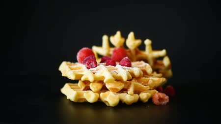 belga : cooked sweet Viennese waffles on a black