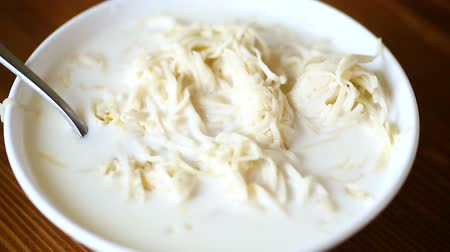 vermicelli : homemade sweet noodles with milk in a plate Stock Footage