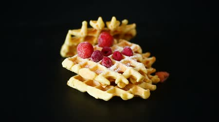viennese : cooked sweet Viennese waffles on a black
