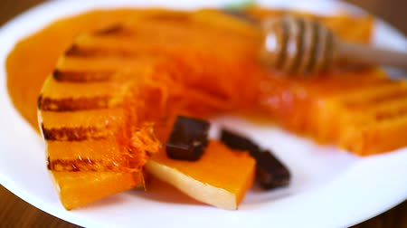 baked pumpkin : grilled sweet ripe pumpkin, in a plate with honey