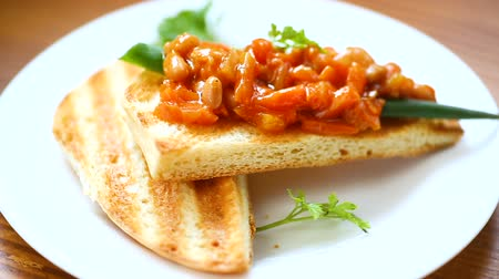 red chili pepper : fried bread toasts with stewed beans and vegetables in a plate
