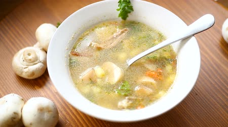 caldo : homemade rural soup with vegetables and mushrooms in a bowl Vídeos