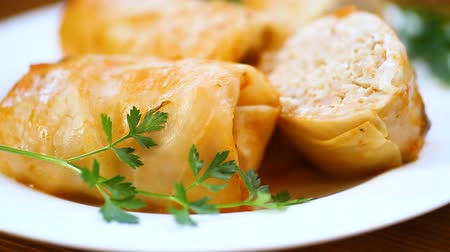 육수 : Stuffed cabbage leaves with minced meat and rice in tomato sauce.