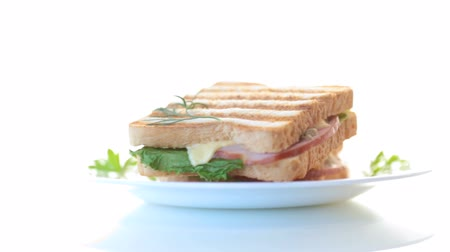broodje kip : fresh sandwich with vegetables, bacon and cheese on a white