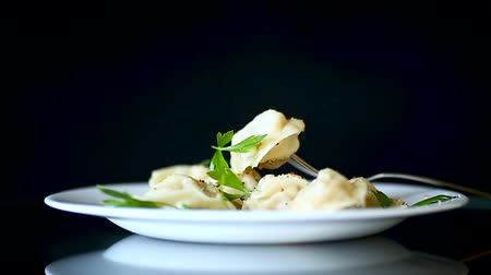 pelmeni : boiled dumplings with meat and spices in a plate