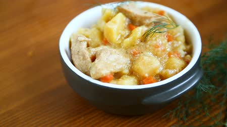 spoons : stewed potatoes with vegetables, cabbage and meat in a bowl