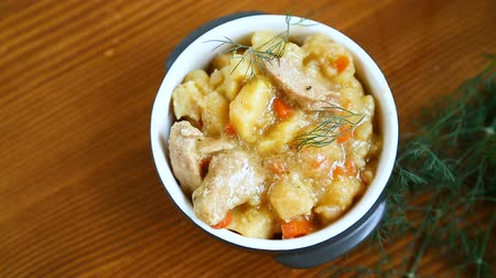 gulasz : stewed potatoes with vegetables, cabbage and meat in a bowl