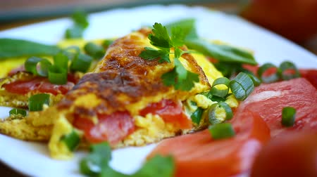 nádivka : fried omelet from homemade organic eggs with tomatoes and green onions