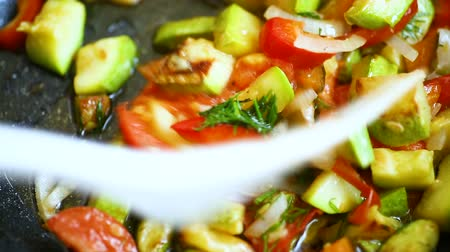 fried zucchini with red pepper, onions, tomatoes and other vegetables