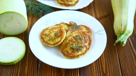 cukkini : vegetable fritters made from green zucchini in a plate