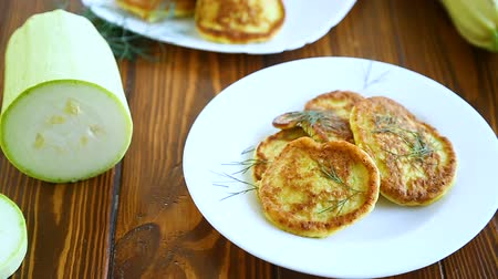 buñuelo : vegetable fritters made from green zucchini in a plate