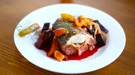 hegycsúcs : fish stew with beets and other vegetables in a plate