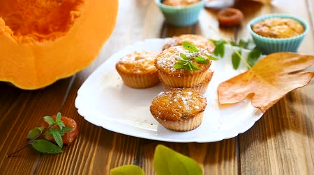 baked pumpkin : baked sweet pumpkin muffins with dried apricots inside,