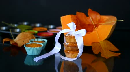baked pumpkin : baked sweet pumpkin muffins with dried apricots inside Stock Footage
