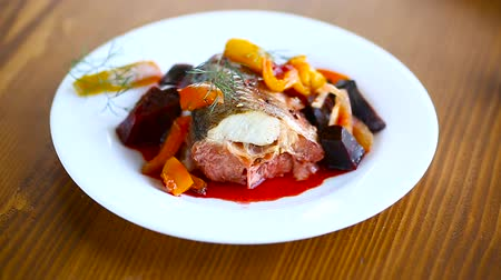 szczupak : fish stew with beets and other vegetables in a plate