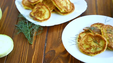 körítés : vegetable fritters made from green zucchini in a plate