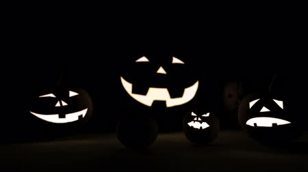 dismay : 3D rendering bunch of Halloween pumpkin lamp in darkness with focus effect
