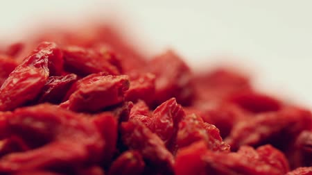 ягоды : Heap of dried goji berries,rotating