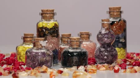 curar : Assorted mini gemstone bottles,rotating