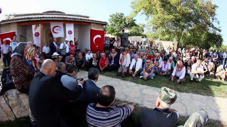 historians : BABADAG,DOBRUJAROMANIA - SEPTEMBER 07:Turks from the Balkans prays at the tomb of Sari Saltik Baba on September 07,  2013 in the ancient city of Babadag ,Romania.Sari Saltik Baba is known to historians all the time as a missionary,a thinker,a philosopher