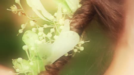 faerie : Young girls playing in a forest. Hair braided with flowers of lime.