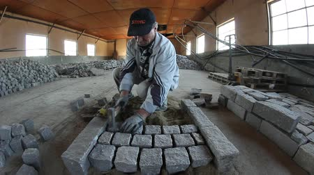 channelling : Mason worker making sidewalk pavement with natural granite blocks (timelapse)