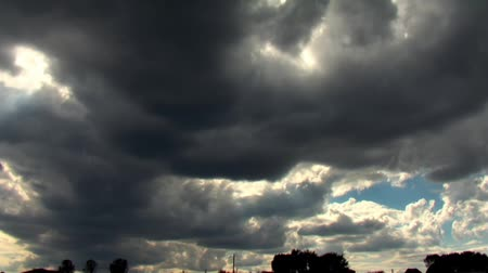 puffy clouds : Dark stormy clouds forming, time lapse