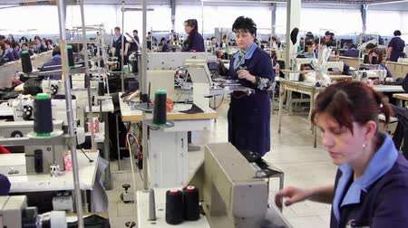 clothing : Workers sewing in a clothing factory