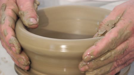 rodas : Hands shaping on a potters kick wheel Stock Footage