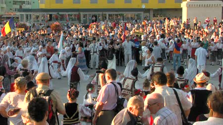 romanian traditional costume : TULCEA, ROMANIA - AUGUST 04: Friendship dance at the International Folklore Festival on August 04, 2012 in Tulcea, Romania.
