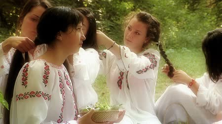faerie : Luncavita, Romania - 24 June 2012: People in the village celebrate the Snziene gentle fairies holiday annually. The most beautiful maidens in the village dress in white and spend all day playing in the forest and picking flowers. Using the flowers they pi