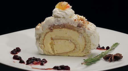 desszertek : Cake with whipped cream on white plate, rotating Stock mozgókép