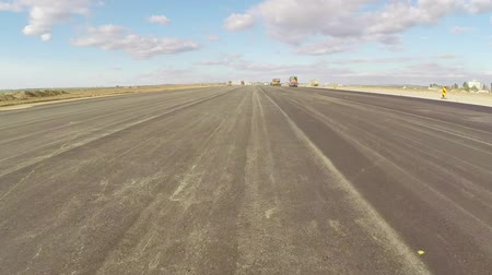 pist : Freshly paved asphalt on an airport runway