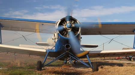 ar : Front view of an old russian biplane with engine running Stock Footage