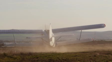 ar : Old russian biplane taking off
