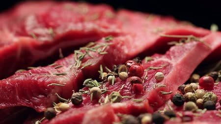 говядина : Fresh raw beef meat with peppercorns ready to grill, rotating Стоковые видеозаписи