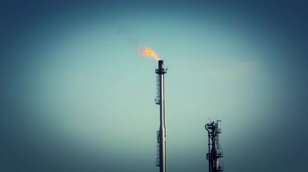 refining : Flaring gases from an oil refinery tower