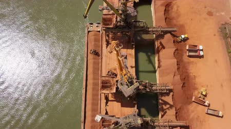 dockyard : Industrial cargo port with operating cranes on the Danube river, aerial view