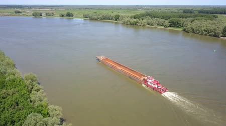minerály : Empty cargo ship on river Danube, aerial view