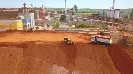 stockpile : TulceaRomania - June 01, 2019: Aerial view of a ore deposit and alumina processing plant