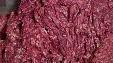 вкусности : Meat mincing machine grinding meat in a meat processing factory