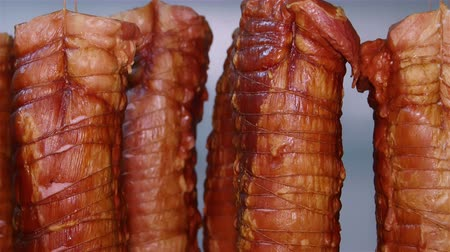 вкусности : Appetizing smoked pork roulades on racks in a meat processing factory Стоковые видеозаписи