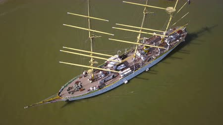 havlama : Tulcea, Romania - 15 September 2019: Training ship Mircea sailing on the Danube, aerial view. Mircea is a A-class, bark type sailing vessel with three masts. Stok Video