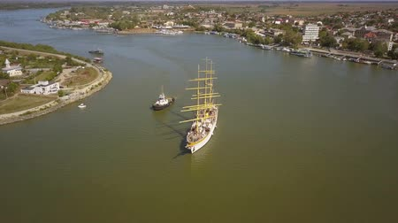 Tulcea, Romania - 15 September 2019: Training ship Mircea sailing on the Danube, aerial view. Mircea is a A-class, bark type sailing vessel with three masts. Archivo de Video