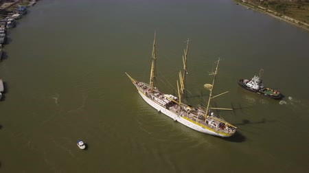 zendmast : Tulcea, Romania - 15 September 2019: Training ship Mircea sailing on the Danube, aerial view. Mircea is a A-class, bark type sailing vessel with three masts. Stockvideo