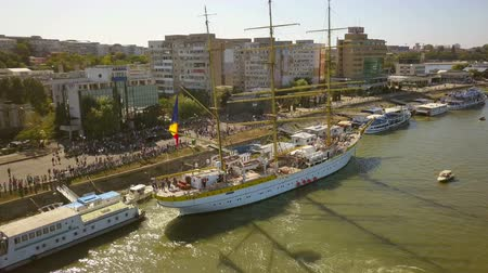Tulcea, Romania - 15 September 2019: Training ship Mircea docking in Tulcea harbor, aerial view. Mircea is a A-class, bark type sailing vessel with three masts. Dostupné videozáznamy