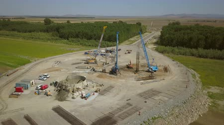Tulcea, Romania - 30 August 2019: The construction of a new suspension bridge over the Danube, aerial view